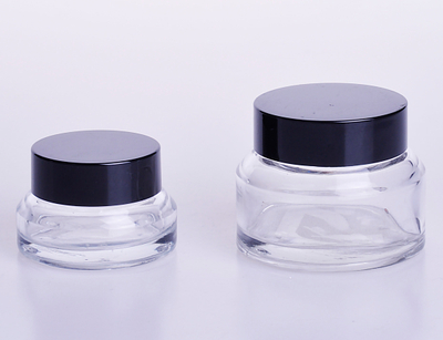 Cream jar with oblique shoulder in clear glass